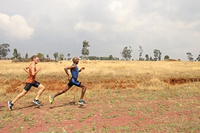 Charlie Grice with Mo Farah training