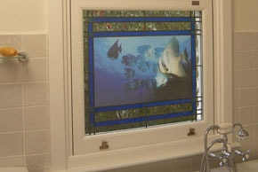 Bathroom window with fish swimming around