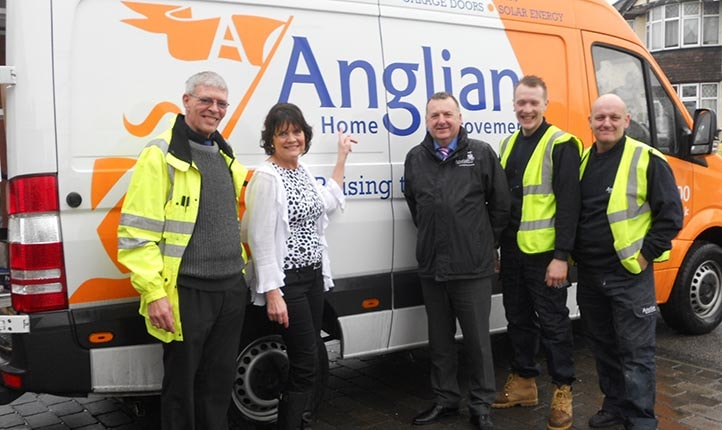 Sally Geeson with members of the Anglian Home Improvements team