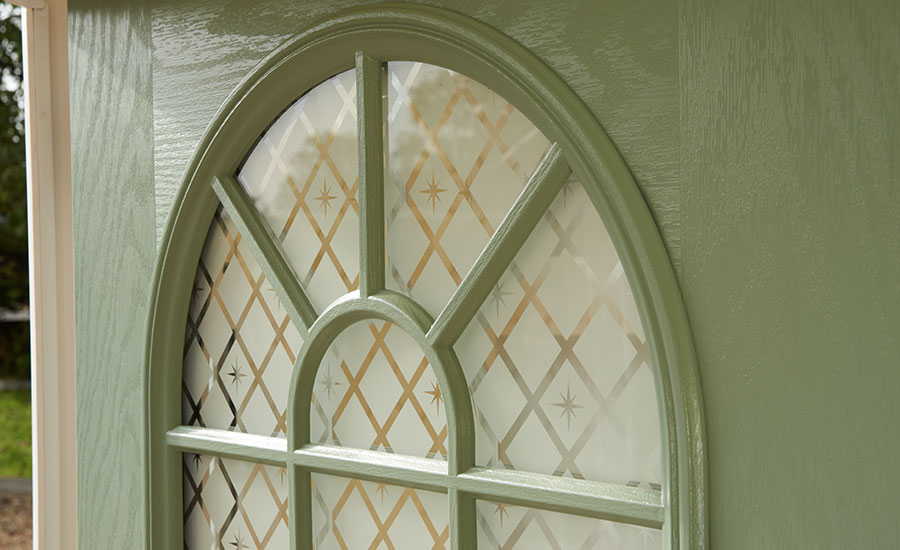 Arched door panel with decorative glazing