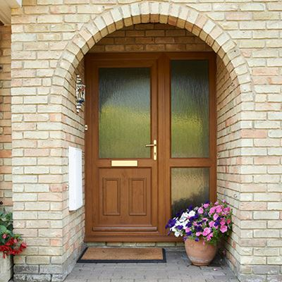 A Golden Oak uPVC front door making a gorgeous entrance to the home