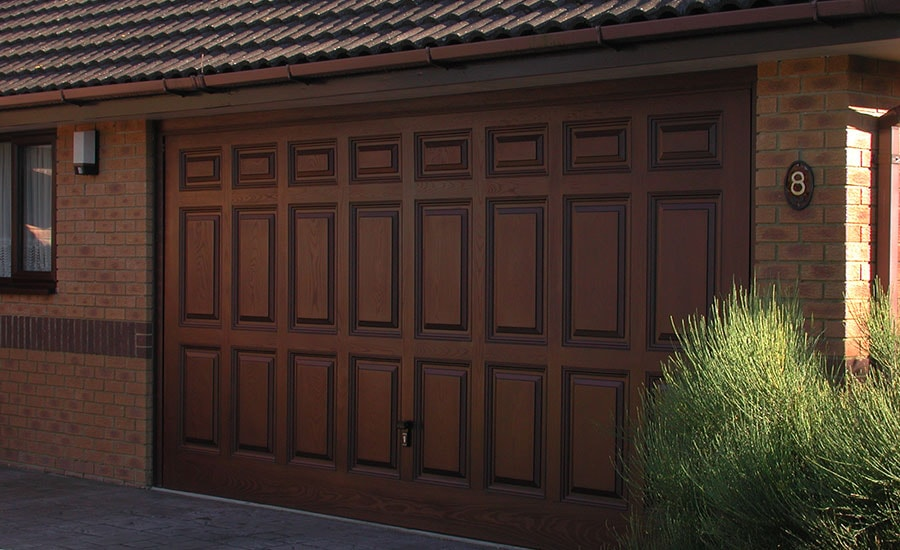 doorsblack dark raised garage doors roof trim brown panel houses white black with