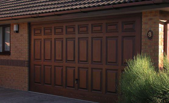 Gallery of sectional garage doors anglian home for 1 piece garage door