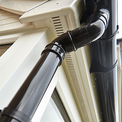 White soffits and black guttering