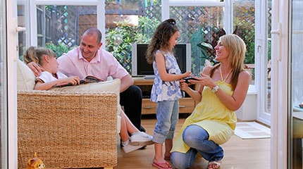 Family enjoys new conservatory installation from Anglian Home Improvements